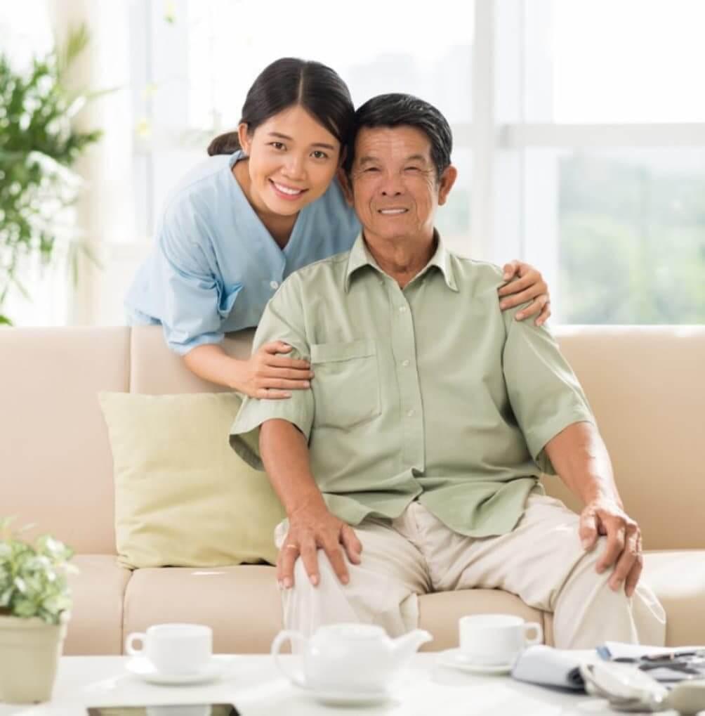 happy caregiver with senior man
