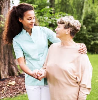 caregiver and senior woman outdoors