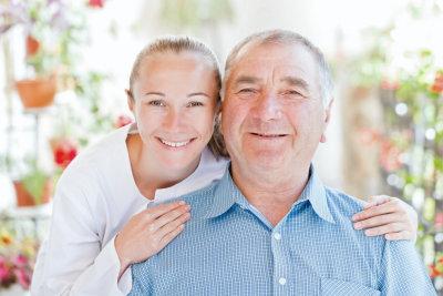 happy caregiver and senior man